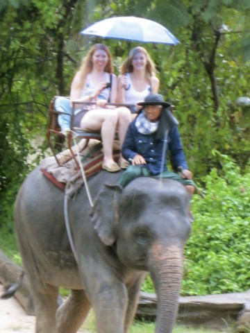 Riding elephants in the rain